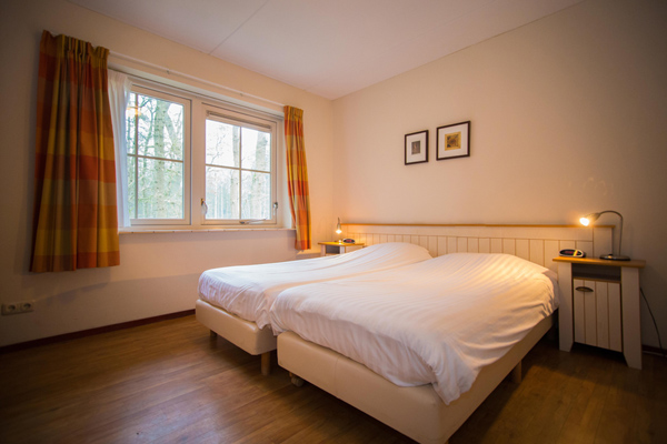 Fredshiem slaapkamer in huis State